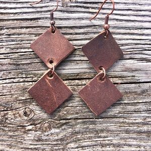 leather earring. Anthropology geometric inspired